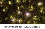 christmas lights shining on an... | Shutterstock . vector #653265871
