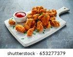 fried crispy chicken nuggets... | Shutterstock . vector #653277379