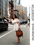 beautiful woman stops a taxi in ...   Shutterstock . vector #653303734