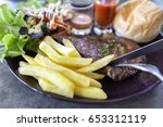 beef steak with french fries... | Shutterstock . vector #653312119
