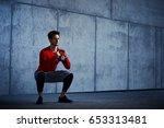 athletic man doing kettlebell... | Shutterstock . vector #653313481