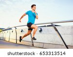 picture of happy man running on ... | Shutterstock . vector #653313514