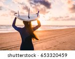 surf girl with long hair go to... | Shutterstock . vector #653320459