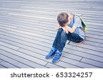 sad  lonely  unhappy  tired ... | Shutterstock . vector #653324257