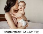 young tender happy mother... | Shutterstock . vector #653324749