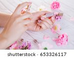 woman applying perfume on her... | Shutterstock . vector #653326117