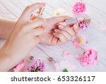 woman applying perfume on her...   Shutterstock . vector #653326117
