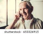 handsome senior man is talking... | Shutterstock . vector #653326915