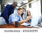 teamwork concept.young creative ... | Shutterstock . vector #653334595