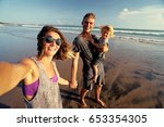 vacation and technology. happy... | Shutterstock . vector #653354305