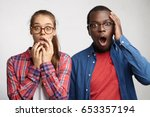frightened two people with... | Shutterstock . vector #653357194