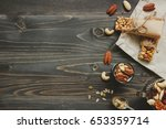 nuts background. healthy bars... | Shutterstock . vector #653359714