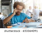 serious african university... | Shutterstock . vector #653364091