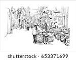 sketch of cityscape in hanoi... | Shutterstock .eps vector #653371699