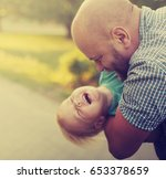 father and son in the summer... | Shutterstock . vector #653378659