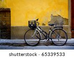 Old Bicycle Parked In Front Of...