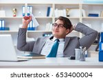 businessman with paper airplane ... | Shutterstock . vector #653400004