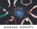 teamwork concept   top view of... | Shutterstock . vector #653403571
