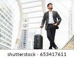 handsome businessman standing... | Shutterstock . vector #653417611