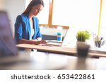 woman sitting on the desk with... | Shutterstock . vector #653422861