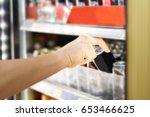 woman's hand open convenience...   Shutterstock . vector #653466625