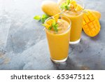 refreshing and healthy mango... | Shutterstock . vector #653475121