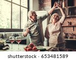 beautiful senior couple is... | Shutterstock . vector #653481589