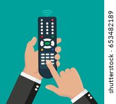 hand holding wireless remote... | Shutterstock .eps vector #653482189
