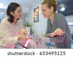 choosing nail polish color | Shutterstock . vector #653495125