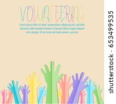 colorful raised hands up with... | Shutterstock .eps vector #653499535
