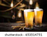 two glass of beer with wheat on ... | Shutterstock . vector #653514751