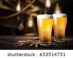 glasses of light beer with... | Shutterstock . vector #653514751
