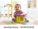 toddler baby boy playing... | Shutterstock . vector #653516545