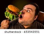 diet failure of fat man eating... | Shutterstock . vector #653543551