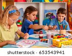 small students painting in art... | Shutterstock . vector #653543941