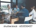 coworking meeting. startup team ... | Shutterstock . vector #653550457