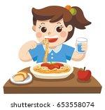 a little girl happy to eat...   Shutterstock .eps vector #653558074