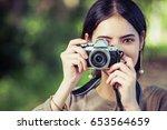 asian young woman take a photo... | Shutterstock . vector #653564659