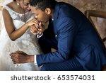 newlywed african descent couple ... | Shutterstock . vector #653574031