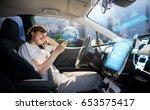 woman using smart phone in... | Shutterstock . vector #653575417