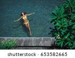 young woman in the pool | Shutterstock . vector #653582665