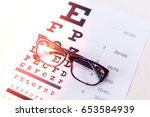 eye glasses on eyesight test... | Shutterstock . vector #653584939