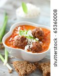 Meatballs in tomato sauce and rice - stock photo
