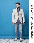 happy handsome man over blue... | Shutterstock . vector #653625175