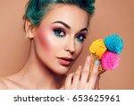 a beautiful young cheerful girl ... | Shutterstock . vector #653625961