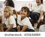 kindergarten students sitting... | Shutterstock . vector #653636884