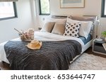 multiple pillows and hat on a... | Shutterstock . vector #653644747
