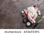 whole raw chicken with herbs... | Shutterstock . vector #653655391