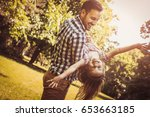 single father playing in the... | Shutterstock . vector #653663185