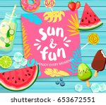 sun and fun lettering on blue... | Shutterstock .eps vector #653672551